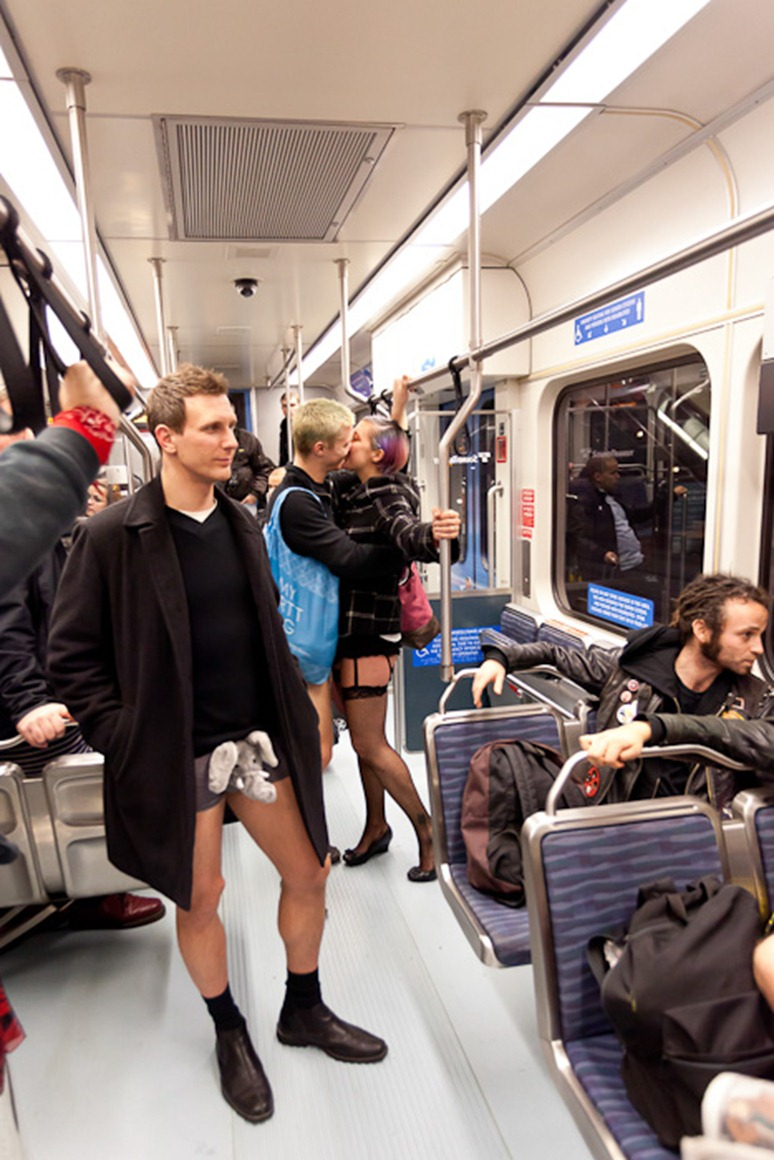Kissing couple Derek Covey and Amber Haworth ride a SoundTransit train during No Pants Light Rail day in Seattle on Sunday, Jan. 8, 2012. In its third year in Seattle, No Pants Subway rides were started 10 years ago in New York City by Improv Everywhere. (Photo/Neil Enns)