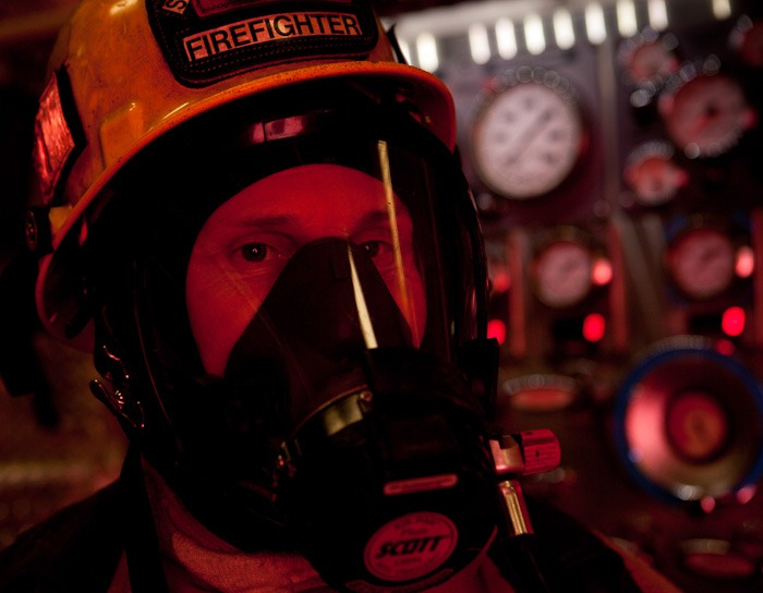Standing in front of a fire engine in Snohomish, WA, on Wednesday, Jan. 25, 2012, firefighter/EMT Matt Nutterbrock is dressed in full protective gear. Nutterbrock is a three year veteran of the department, based at Station 72, headquarters for Snohomish County Fire District 7. (Photo/Neil Enns)
