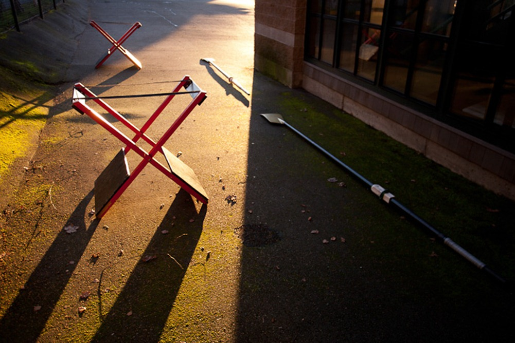 Shell stands and oars lie outside in the morning sun at the Lake Washington Rowing Club in Seattle on Friday, Feb. 3, 2012. Founded in 1957, the not-for-profit club offers a range of classes from introductory lessons to member-specific programs. (Photo/Neil Enns)