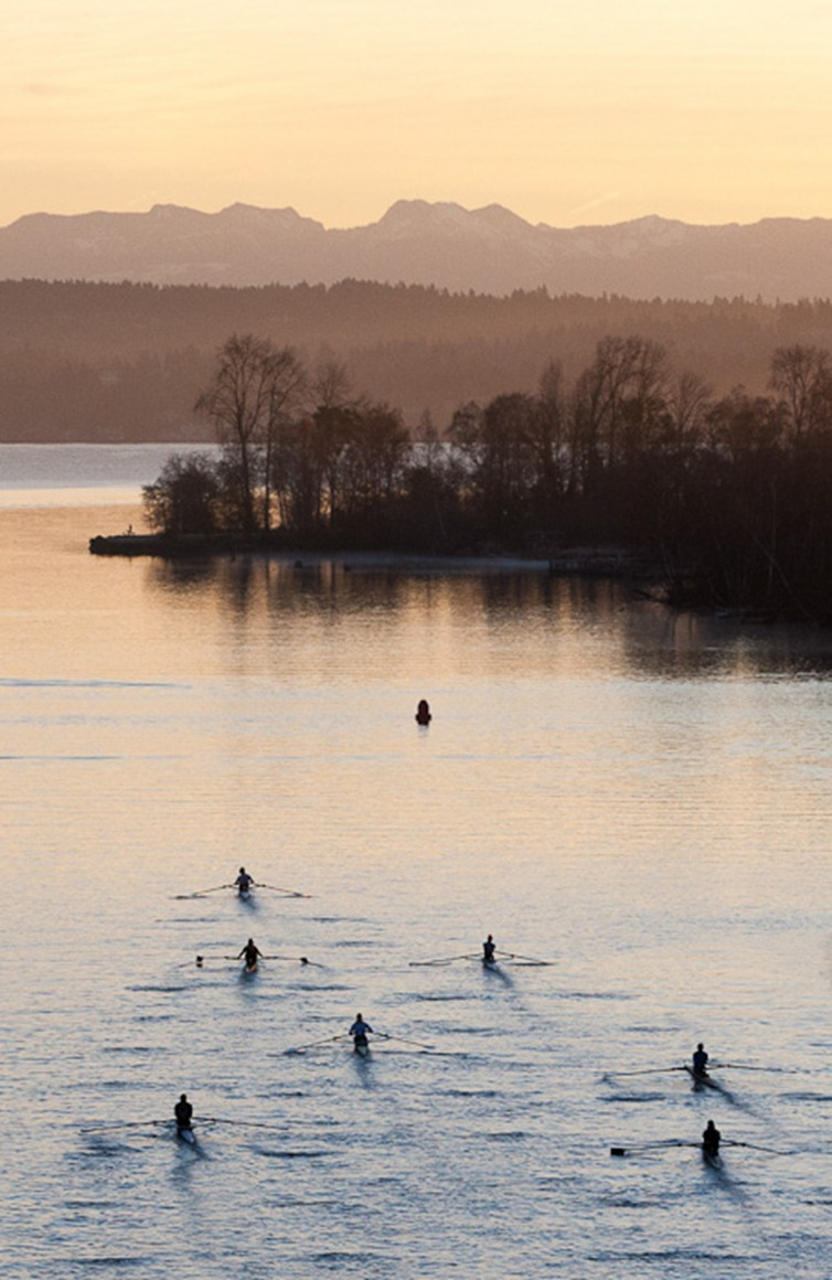 A group of rowers head towards Lake Washington in Seattle on Monday, Feb. 6, 2012. (Photo/Neil Enns)