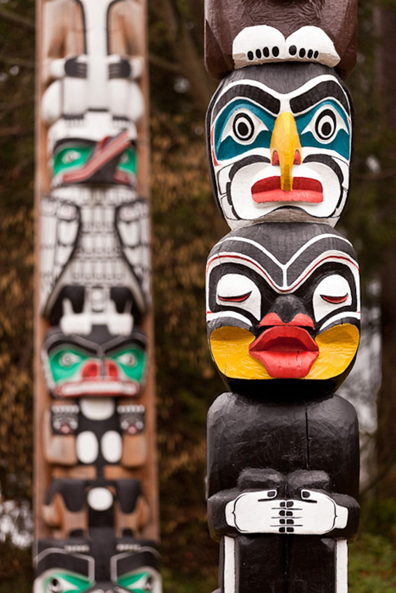The Kakaso'las totem pole, front, stands in Stanley Park, Vancouver, BC, on Sunday, Feb. 12, 2012. Carved by Ellen Neel and her uncle Mungo Martin, the pole was completed in 1955 for the Woodward's Department Store. (Photo/Neil Enns)
