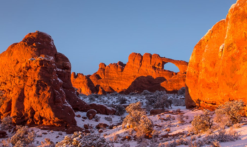 Skyline Arch, in Arches National Park, UT, is washed in golden light at sunset on Saturday, Feb. 23, 2013. (Photo/Neil Enns)