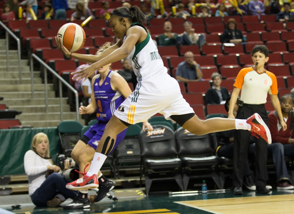 Renee Montgomery flies through the air as she attempts to save a ball headed out-of-bounds. (Neil Enns/Storm Photos)