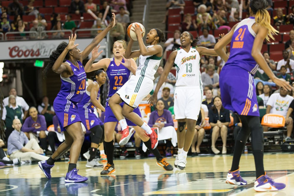 Renee Montgomery levitates through the Mercury defense. (Neil Enns/Storm Photos)